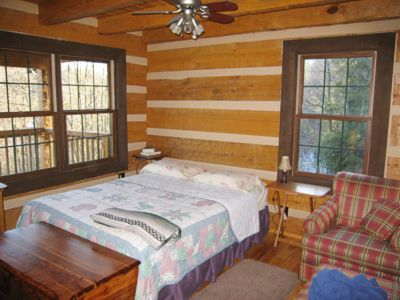 Large deluxe vacation cabin rentals in the hocking hills hemlock log cabins ohio Master bedroom upstairs or downstairs